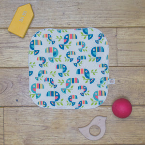 An Organic Poco Bambino reusable wash cloth / wipe in a toucan tango print.