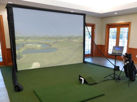 golf simulator projector screen with turf and launch monitor