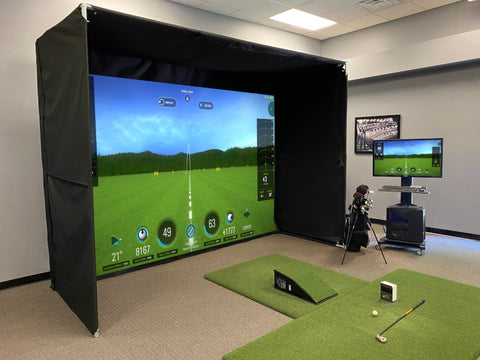 full golf simulator set-up with projector screen, turf, launch monitor and PC