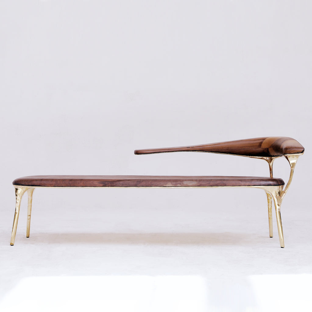 BRASS AND WALNUT LOUNGE CHAIR