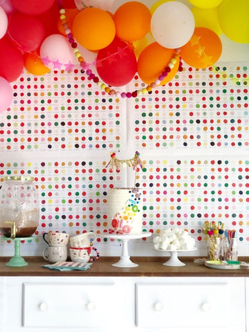 rainbow party backdrop with balloons