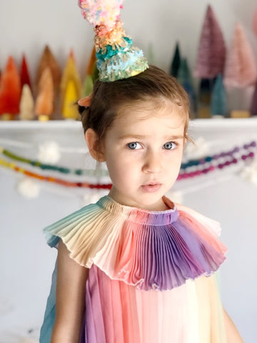 four year old in front of party decorations