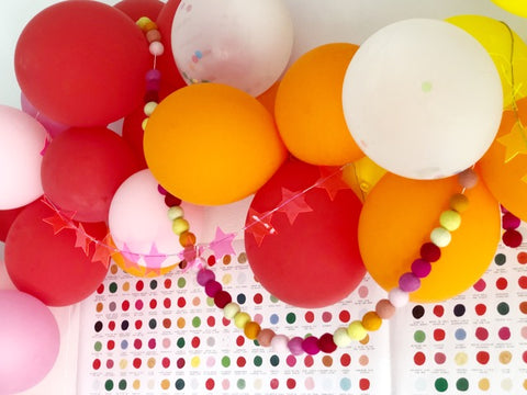 balloon and felt ball garlands for rainbow christmas party