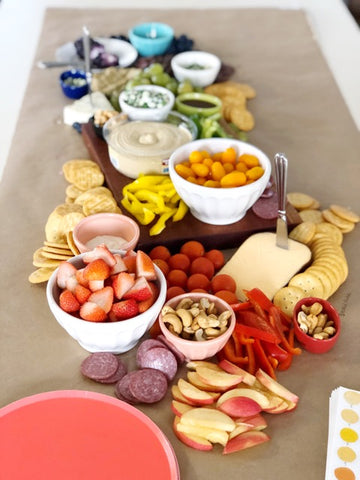 rainbow cheese board and charcuterie display