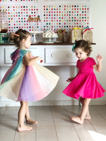 girls in twirling dresses at birthday party for four year olds