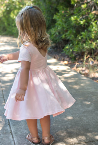 young blonde girl in pink dress