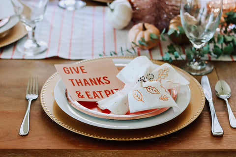 place settings with modern cards for friendsgiving