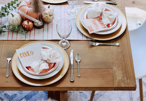 beautiful thanksgiving table with paper plates and chargers