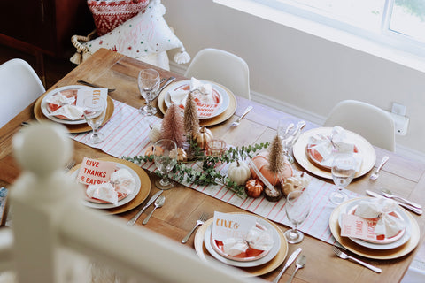 Friendsgiving table settings with paper plates