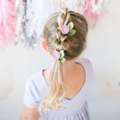 blonde little girl in lavender twirl dress and felt flower bows