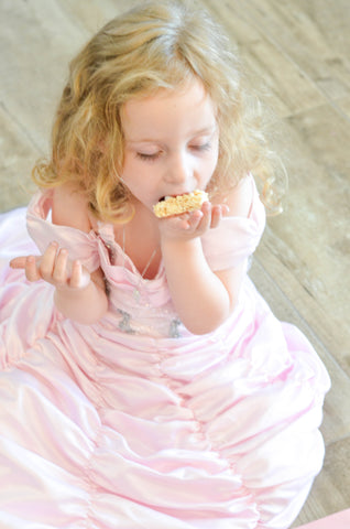 girl enjoying her rice krispy treat