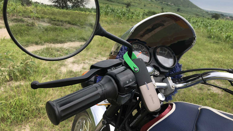 Rafael Muvunga attaches the goTenna Mesh to his motorcycle to enable off grid communication with his colleague