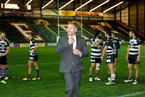 Widnes Vikings' coach Denis Betts in his Chess London suit and club tie
