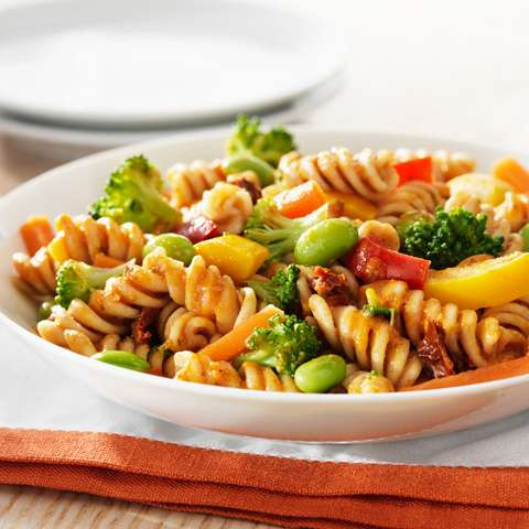 Cooked pasta mixed with stir fried vegetables