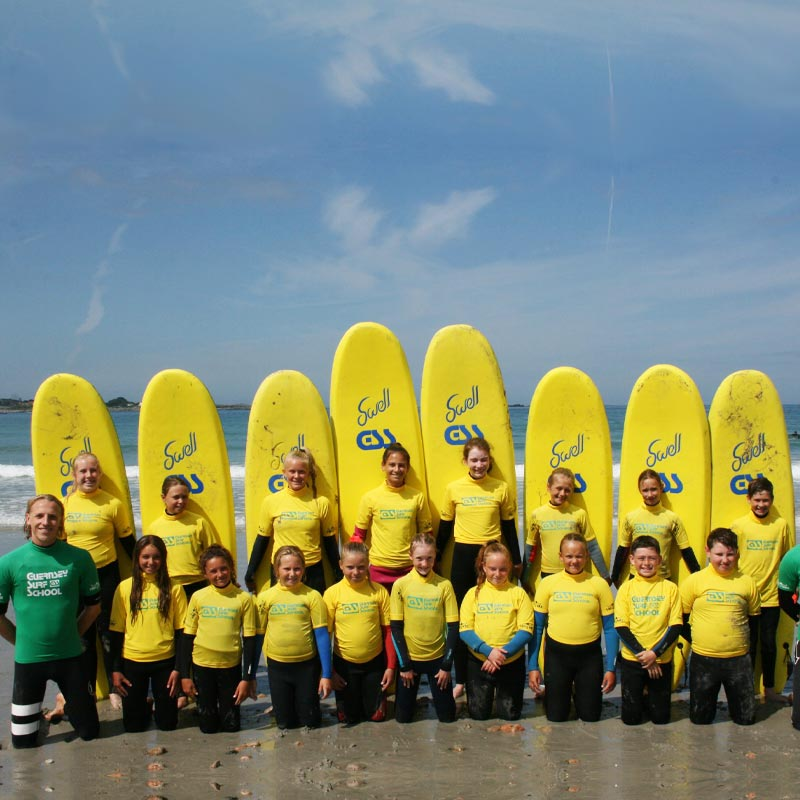 all day summer camp lessons Guernsey surf school