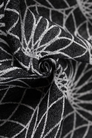 Lenny Lamb 100% linen fabric in Lotus - Black, a black background with white outlined lotus flowers