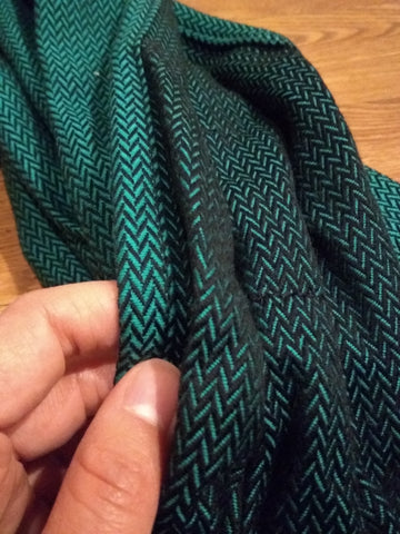 Close up of shoulder strap wrap material of Lenny Hybrid, Lenny Lamb's half buckle meh dai carrier, in Emerald, a green herringbone print