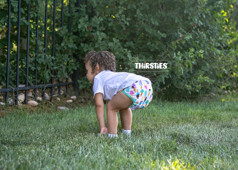 Child models Thirsties cloth diaper