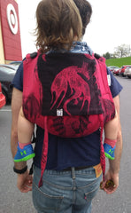 husband of founder carrying their child in a Lenny Lamb Dragon Fire & Blood Toddler Onbuhimo