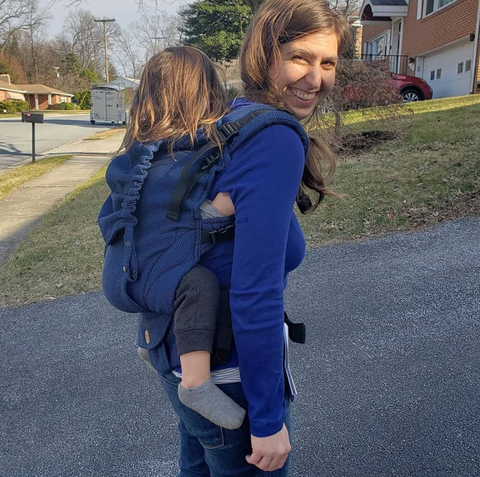 Alexandra, the founder of Mama & Roo's, carrying her son in the tester preschool carrier