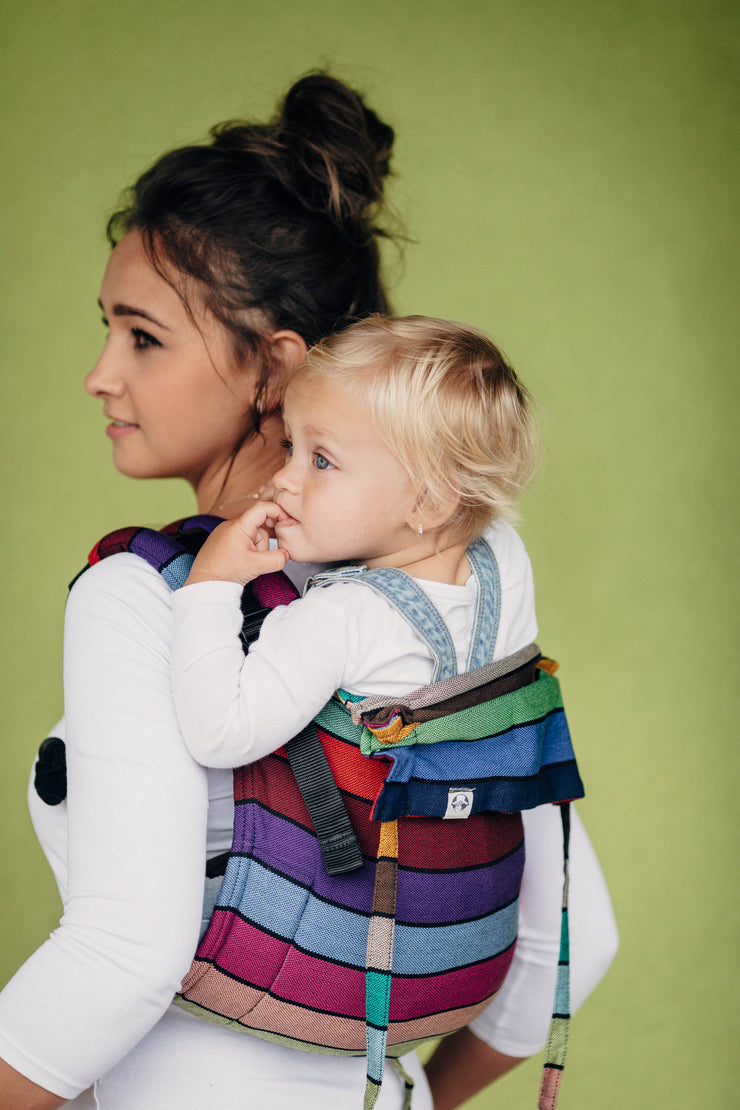 Model is back carrying child in Lenny Lamb buckle onbuhimo in print Carousel of Colors