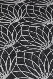 Close up of a fabric of Lenny Lamb brand ring sling in Jacquard weave linen, print Lotus - Black.