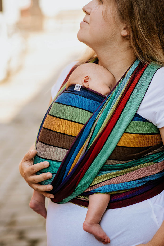 Lenny Lamb Long Woven Wrap - Carousel of Colors - newborn FWCC closeup. Wrap has horizontal stripes in rainbow colors with thin black stripes in-between the colors