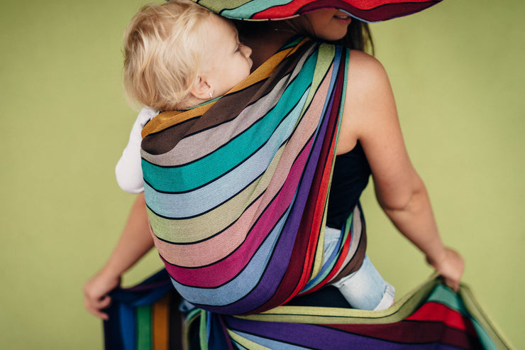Lenny Lamb Long Woven Wrap - Carousel of Colors - toddler back carry. Wrap has horizontal stripes in rainbow colors with thin black stripes in-between the colors