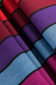Lenny Lamb Long Woven Wrap - Carousel of Colors - Fabric close up. Wrap has horizontal stripes in rainbow colors with thin black stripes in-between the colors