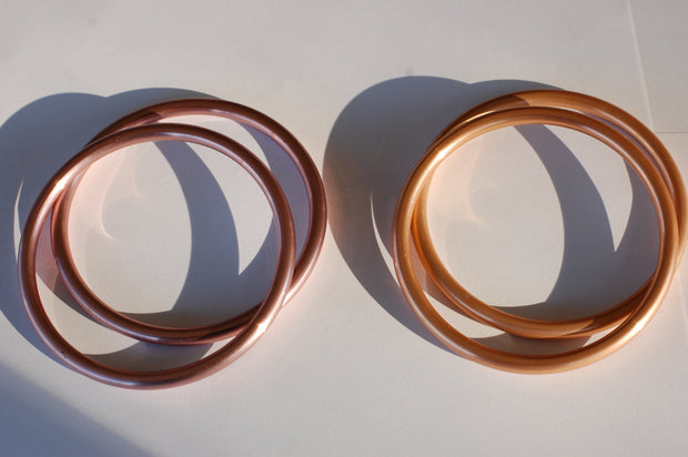 large hand-buffed rose gold compared to large copper sling rings