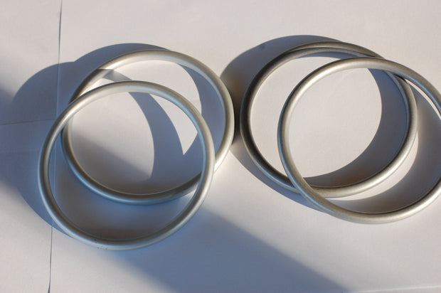 Silver sling rings compared to slate sling rings