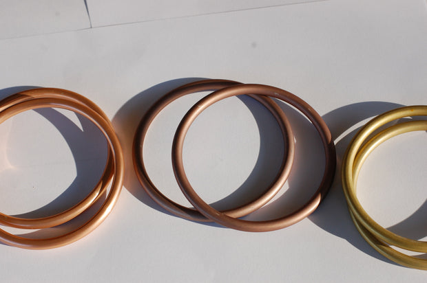 Large Copper sling rings left, Large Mauve sling rings center, Large Gold Sling Rings right large gold sling rings