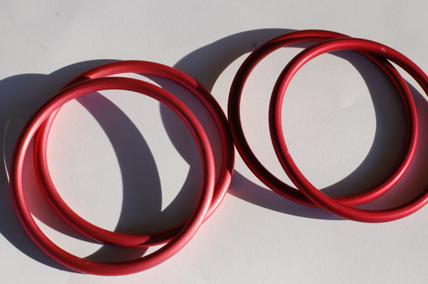 Large Dark pink sling rings (left), Large Red Sling Rings (right)