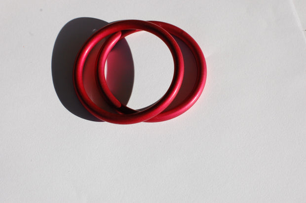 small red sling rings