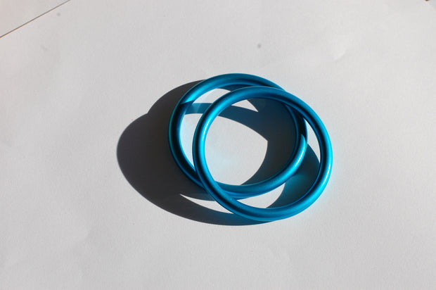 small turquoise sling rings
