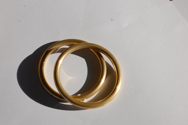 small hand-buffed Gold sling rings