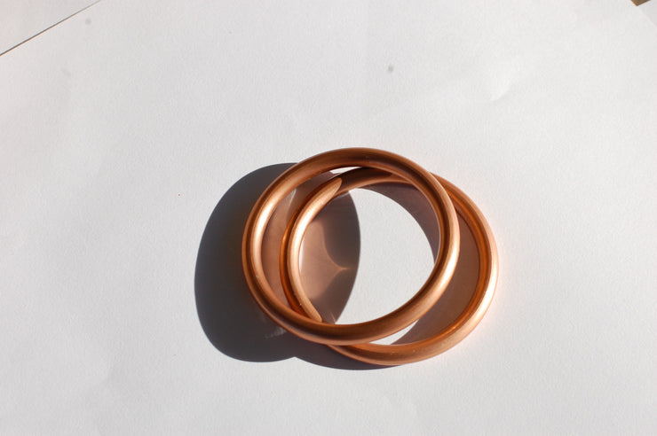 Small hand-buffed copper sling rings