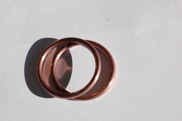 small hand-buffed rose gold sling rings