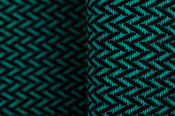 Lenny Lamb long woven wrap - Little Herringbone Emerald - Rich emerald green with herringbone weave and a black weft. Fabric closeup showing the black herringbone weave detail