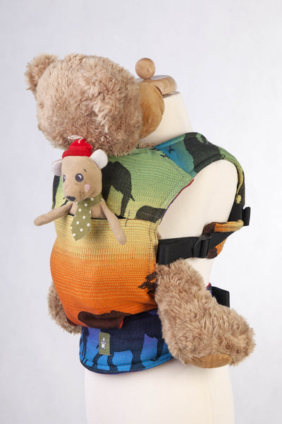Lenny Lamb Rainbow Safari 2.0 Doll Carrier with pocket, holding teddy bear