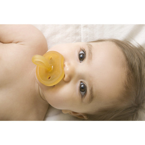 Baby using Natursutten rubber Butterfly pacifier. Made in Italy.