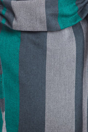 Close up of a Lenny Lamb brand buckle onbuhimo baby carrier in print Smoky Mint. The print has vertical stripes in various shades of grey, accented with mint green stripes.
