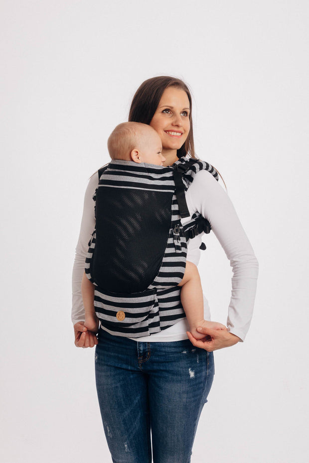 Lenny Lamb brand soft structured fully adjustable baby carrier (SSC) the Lenny Upgrade in print Light and Shadow with black mesh panel. Full view, shows pocket and height adjuster