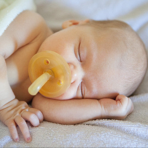 Newborn baby using Natursutten rubber Original pacifier. Made in Italy.