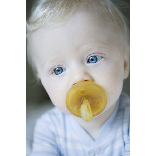 Baby using Natursutten rubber Original pacifier. Made in Italy.