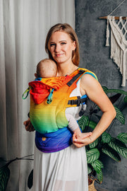 neutral pose. Lenny Lamb brand soft structured baby carrier (SSC) the LennyGo in print Rainbow Baby