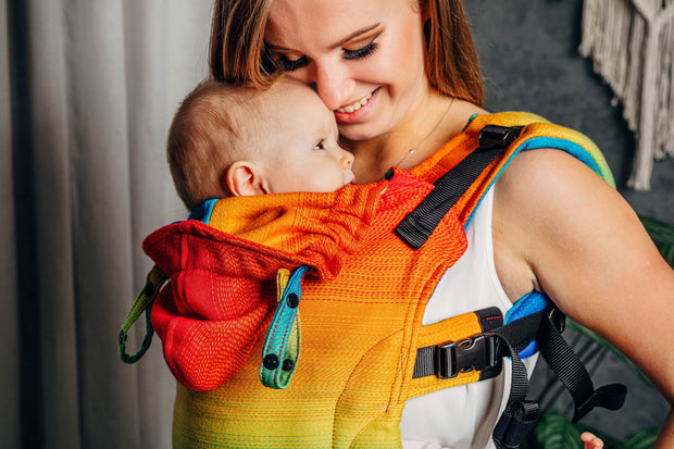 closeup Lenny Lamb brand soft structured baby carrier (SSC) the LennyGo in print Rainbow Baby