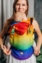 full front view. Lenny Lamb brand soft structured baby carrier (SSC) the LennyGo in print Rainbow Baby