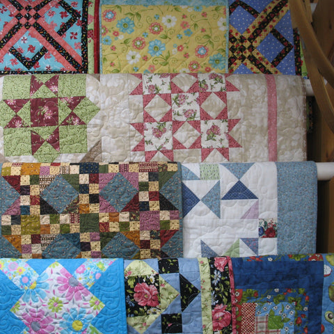 quilts on rack