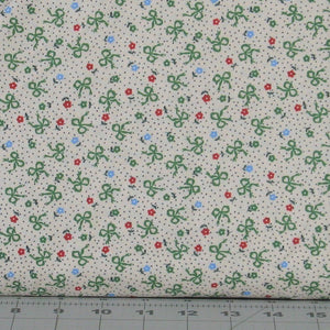 Green Ribbons, Small Red and Blue Flowers on a White Dotted Background from the Greetings Collection by Kaye England for Wilmington Prints, 98620-174